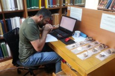 Figure 1. Yusuf Tuna analysing Early Bronze Age pottery in the pottery collection of the British Institute at Ankara.